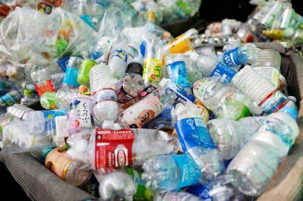 FILE PHOTO: Used plastic bottles are seen at a waste collection point in Tokyo